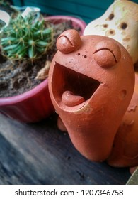Beautiful smile stone or baked clay turtle for decoration garden