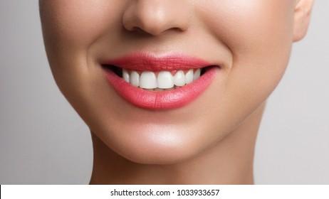 Beautiful smile with whitening teeth. Dental photo. Macro closeup of perfect female mouth, lips care. Stomatology, cosmetology