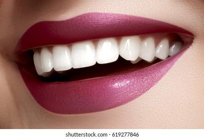 Beautiful smile with whitening teeth. Dental photo. Macro closeup of perfect female mouth, lipscare rutine.