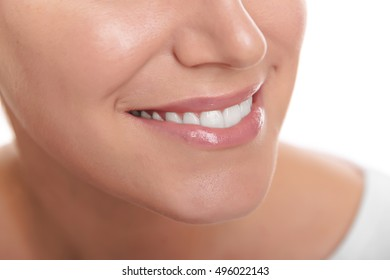 Beautiful smile of young woman. Closeup photo.