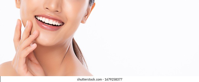 Beautiful smile young woman. White teeth on white background,