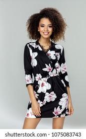 Beautiful smiling african american female model wear dress in flowers