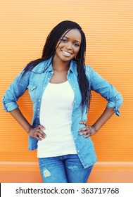 Beautiful smiling african woman over orange background