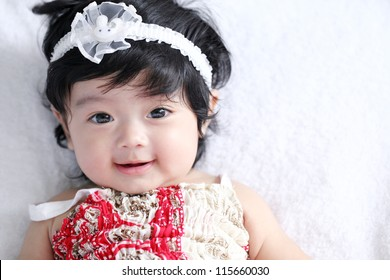 A beautiful smiling asian baby