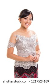 Beautiful smiling Asian girl wearing a set of modern styled Kebaya, the traditional female outfits originated from Indonesia. Indoor studio portrait