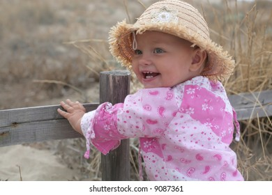 beautiful smiling baby girl at the fence