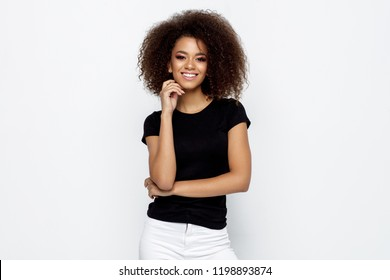 Beautiful smiling black woman isolated on white