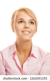 Beautiful smiling blonde young woman in pink shirt close-up, isolated on white background.