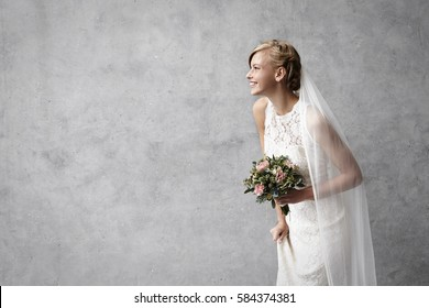 Beautiful smiling bride in studio