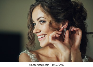 beautiful smiling bride wearing earring