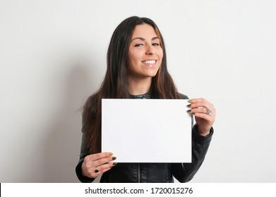 beautiful smiling brunette girl with placard, on white background