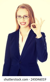 Beautiful smiling business woman showing perfect sign.
