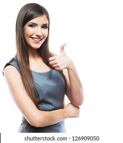 Beautiful smiling business woman standing against white background. Thumb up.