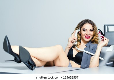 A beautiful smiling business woman talking on the phone