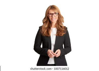 Beautiful smiling businesswoman wearing suit and looking at camera while standing at isolated white background.
