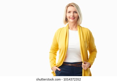 Beautiful smiling elderly lady wearing casual clothes while standing at isolated white background.