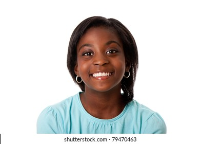 Beautiful smiling face of a happy African teenager girl, isolated.