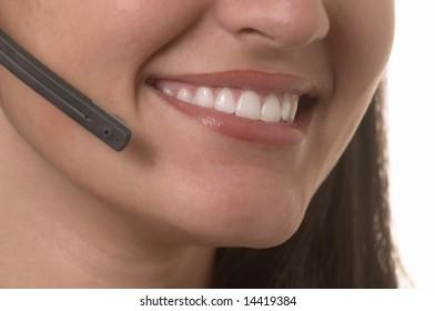 Beautiful smiling female hotline operator with headset
