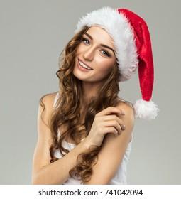 Beautiful smiling female model wear santa hat