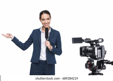 beautiful smiling female television reporter with microphone looking at camera, isolated on white