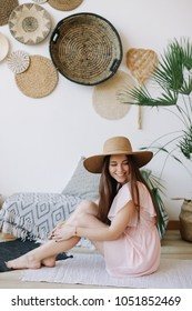 A beautiful smiling  girl in a hat. Summer beauty. Romantic shot