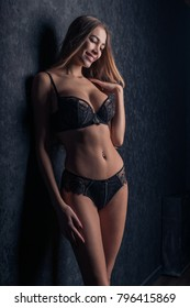 Beautiful smiling girl model in sexy lingerie