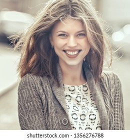 Beautiful smiling girl outdoor portrait - close up