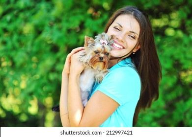 Beautiful smiling girl portrait with puppy yorkshire terrier