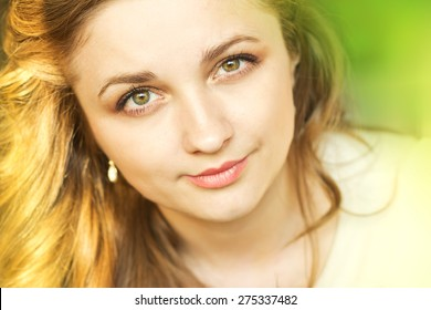 beautiful smiling girl relaxing on nature.Face of a beautiful young girl. Portrait outdoors.