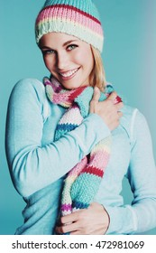 Beautiful smiling girl wearing scarf