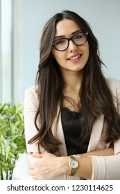 Beautiful smiling girl at workplace look in camera portrait. White collar dress code worker at workspace job offer modern office lifestyle client visit study profession boss market idea coach train.