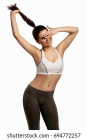 Beautiful smiling happy slim young sporty fitness woman