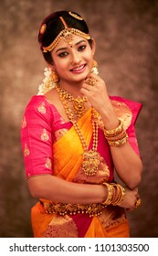 Beautiful smiling Indian bride with jewelry in studio shot