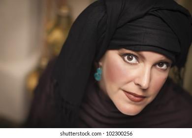 Beautiful Smiling Islamic Woman Wearing Traditional Burqa or Niqab.
