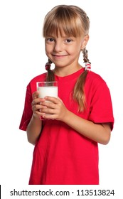 Beautiful smiling little girl with a glass of milk isolated on white background