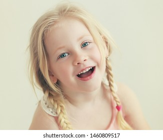 beautiful smiling little girl looking at camera
