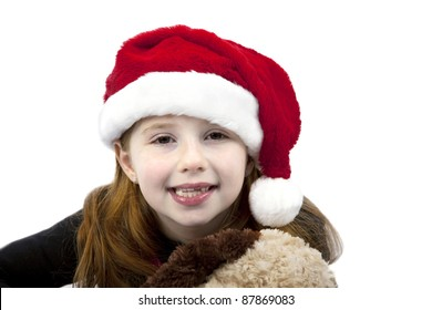 Beautiful smiling little girl wearing Santa hat