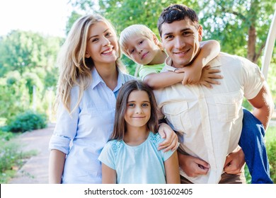 Beautiful smiling Lovely family in park