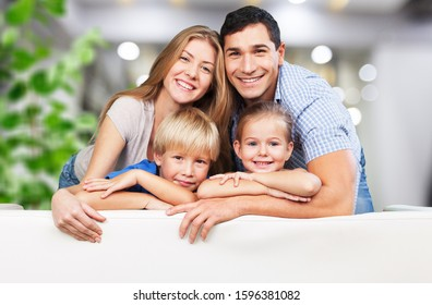 Beautiful smiling Lovely family siting on sofa