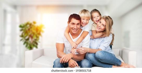 Beautiful smiling lovely family sitting on sofa
