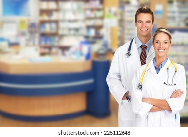 Beautiful smiling pharmacist woman in a drugstore