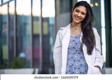 Beautiful smiling portrait of Indian American woman, medical practitioner, dental hygienist, scientist, health care specialist in medicine