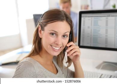 Beautiful smiling teleoperator with headset on