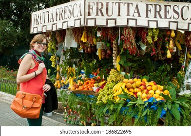 beautiful smiling tourist at a local market in Rome, Italy