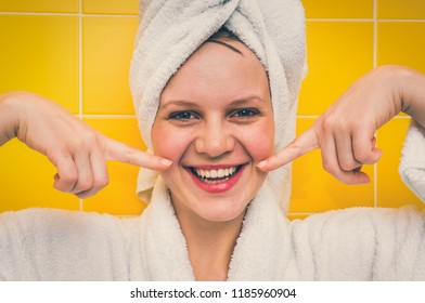 Beautiful smiling woman in bathrobe with towel on her head - retro style