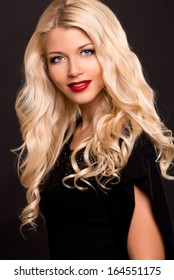 Beautiful smiling woman. Beautiful  blond woman with evening make-up and hairstyle.