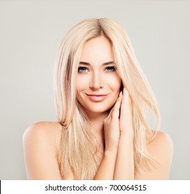 Beautiful Smiling Woman with Blonde Hair. Blondie Fashion Model with Shiny Skin and Natural Makeup