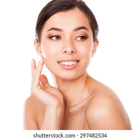 Beautiful smiling woman cares for the face
