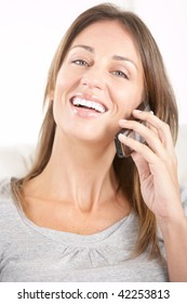 Beautiful smiling woman with cellular at home