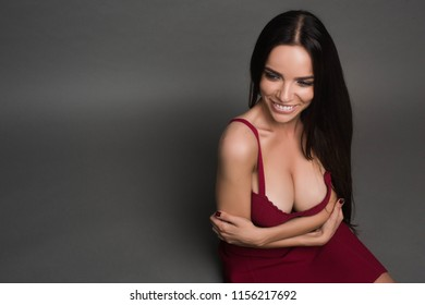 Beautiful smiling woman with clean skin, natural make-up, and white teeth with bright smile and beautiful long hair looking happily at camera. Portrait of trendy, cheerful, modern, nice, stylish, cute